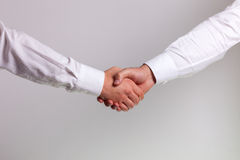 Hand shake. Between a businessman Royalty Free Stock Photography