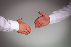 Hand shake. Between a businessman Royalty Free Stock Images