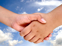 HAND SHAKE. Hand in focus Royalty Free Stock Photography