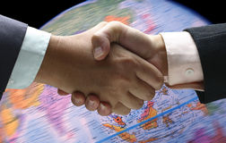 Hand shake background foreign currency stock photos