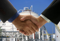 Hand shake background oil refinery Royalty Free Stock Photos