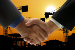 Hand shake background oil refinery Stock Photography