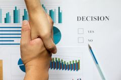 Hand shake between business man on blur decision and financial g Stock Photography