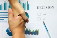 Hand shake between business man on blur decision and financial g Stock Images