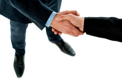 Hand shake between a business people Stock Photography