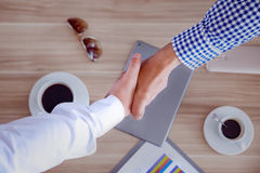 Hand shake business, top view of two men shaking hands business Stock Photography