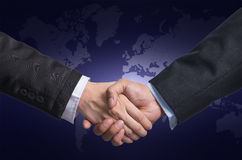 Hand shake between a businessman and a businesswoman on world ma Stock Photos