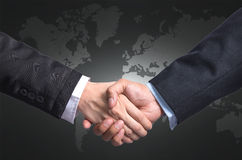 Hand shake between a businessman and a businesswoman on world ma Stock Photography