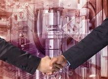Hand shake between a businessman on Industrial equipment backgro. Und Stock Photos