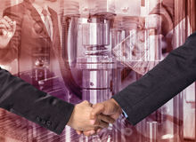Hand shake between a businessman on Industrial equipment backgro Stock Images