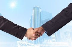 Hand shake between a businessman on Modern business building gla Stock Photography