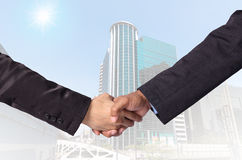 Hand shake between a businessman on Modern business building gla Stock Image