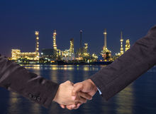 Hand shake between a businessman on Petrochemical factory backgr Royalty Free Stock Photos
