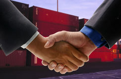 Hand shake at cargo port Royalty Free Stock Photo