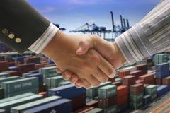 Hand shake at cargo port Stock Photo