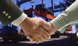Hand shake at cargo port Stock Images