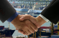 Hand shake at cargo port Royalty Free Stock Photography