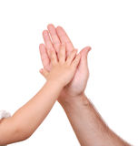Hand shake of the child and father Stock Photos