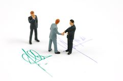 Hand shake and contract Royalty Free Stock Image