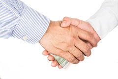 Hand shake deal with corrupt cash exchange Royalty Free Stock Photos
