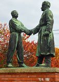 Hand-shake at Hungarian-Soviet Friendship Memorial at Memento Park Budapest Hungary. USSR Communist soviet style arts and statue. Memento Park, or Szoborpark is royalty free stock images