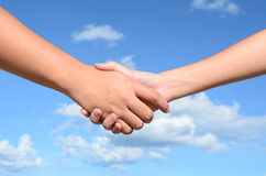 Hand shake between a man and a woman Royalty Free Stock Photography