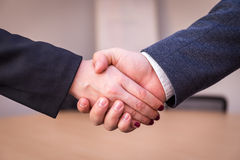 Hand shake in the office.  Stock Image