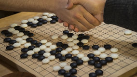 Hand shake before play Chinese board game Go or Weiqi. For respect Stock Photography