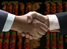 Hand shake at stock index stock image