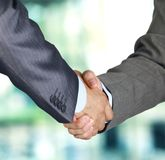 Hand shake between two colleagues. Closeup of a business hand shake between two colleagues Stock Images