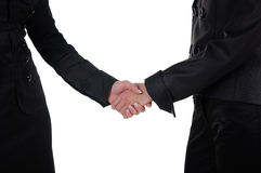 Hand shake of two women Stock Photos