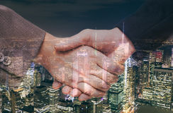 Hand shake and urban background Royalty Free Stock Image