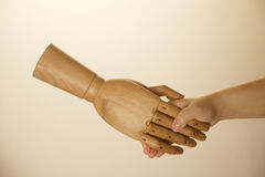 Hand shaking wooden hand Stock Image