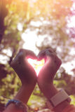 Hand in shape of heart for love. Royalty Free Stock Photos