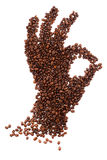 Hand shape made of coffee beans over white background Stock Photo