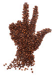 Hand shape made of coffee beans over white background Royalty Free Stock Images