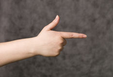 Hand shaped as a gun Stock Images