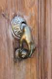 Hand shaped door knocker Stock Photography