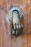 Hand shaped door knocker Stock Image