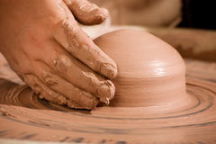Hand shaping wedge of clay Stock Photography