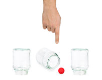 Hand and shell game with glass jars Stock Photos