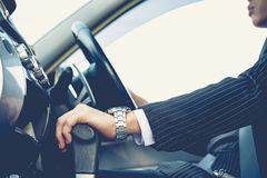 Hand shifting the gear stick,business man. Driving car,vintage tone Stock Photos