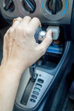 Hand shifting the gear stick. Driver hand shifting the automatic gear stick Stock Images