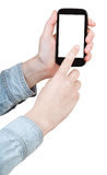 Hand in shirt clicking smartphone isolated Stock Photography
