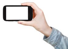 Hand in shirt holding touchscreen phone isolated Stock Photos