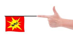 Hand shooting bang flag concept. Female hand shooting bang flag concept isolated on white background Stock Photos