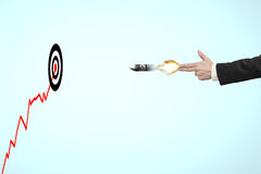 Hand shooting gesture with money symbol on bullet and target Royalty Free Stock Photo
