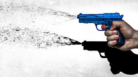 Hand shooting water pistol, 70s style Stock Photo