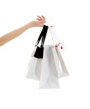 Hand with shopping bags. Hand with three shopping bags over white Stock Image