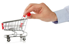 Hand with shopping cart Stock Images